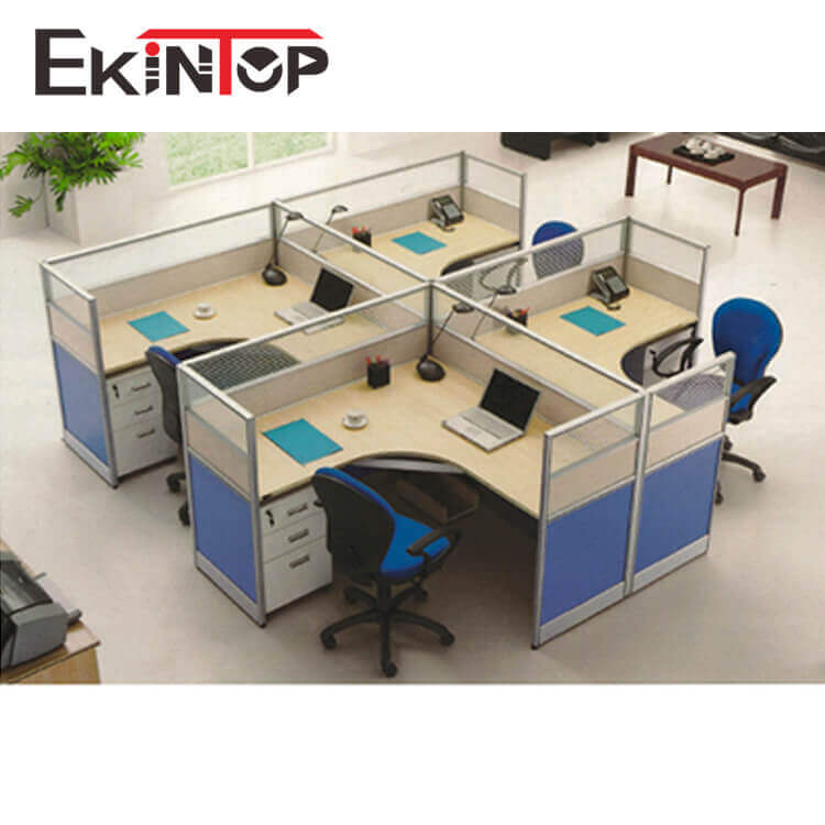 four people office workstation